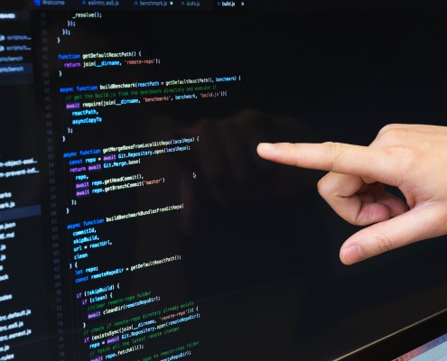 finger-pointing-at-javascript-code_4460x4460